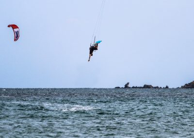 Jumping in front of Siroko Wind Club at Keros beach