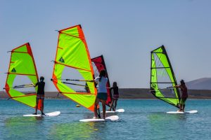 Kids lessons in keros beach in front of Siroko Wind Club